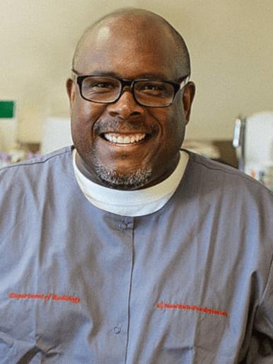 man smiling in medical gear