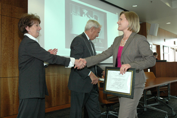 LITeS participant Jori Leszczynski receives her program certificate from university leadership