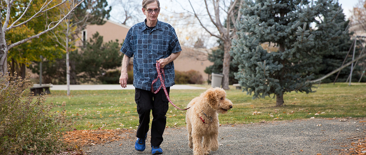 Louis and his poodle, Doodles, on one of their four walks every day