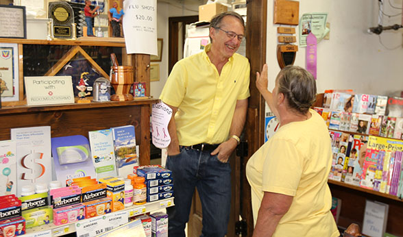 Don Colcord chats with longtime friend and customer Susan Rice at his pharmacy.