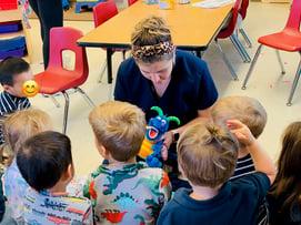 Sheaffer Skadsen teaching young children about good dental hygiene habits