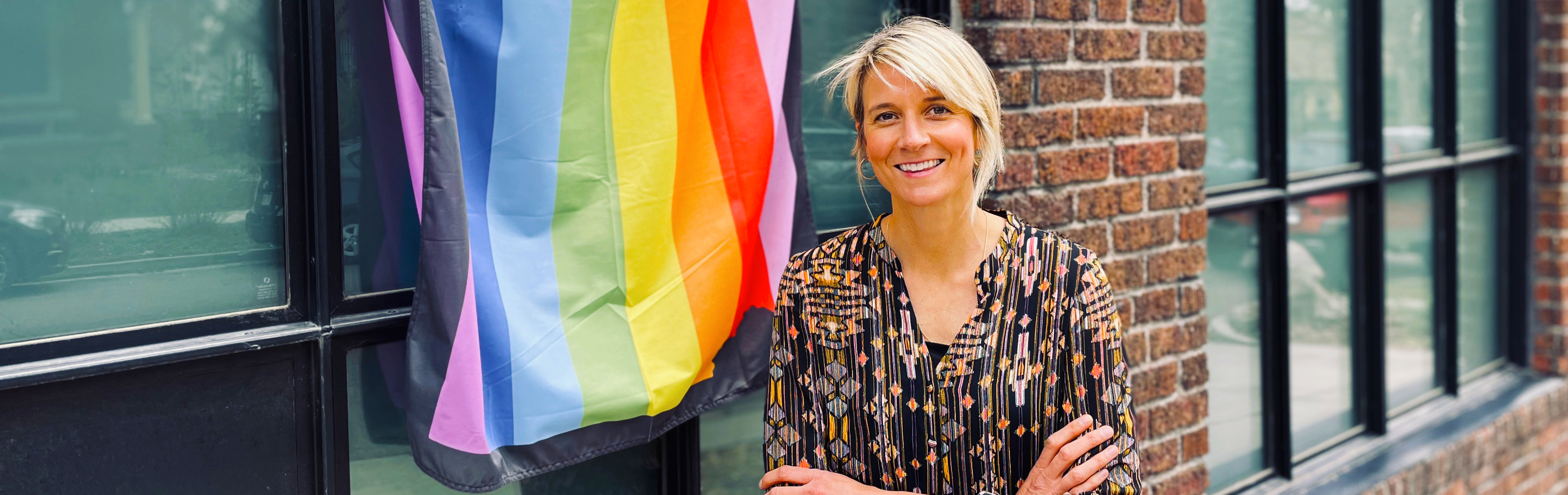 Carey Candrian stands by pride flag
