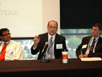 From left, panelists Robin Shandas, Andrew Thorburn and Rick Duke speak at an ARCS meeting at CU Anschutz
