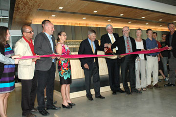 The CAP second floor renovation is celebrated with a ribbon cutting and grand opening