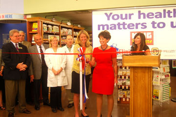Lilly Marks, vice president for health affairs at the University of Colorado, cuts ribbon at King Soopers announcing partnership