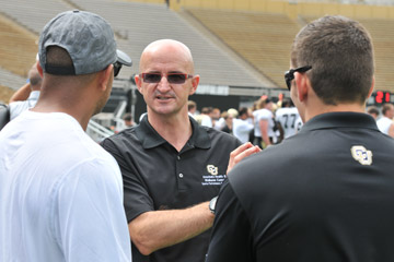 Iñigo San Millán, PhD, speaks with CU Buffs football coaches