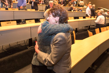 Lilly Marks is hugged by a colleague at the Anschutz Medical Campus following her State of the Campus address