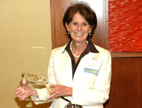 Lilly Marks, vice president of health affairs at the University of Colorado, stands with her Outstanding Woman in Business award