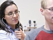 A doctor treats a patient at Anschutz Medical Campus