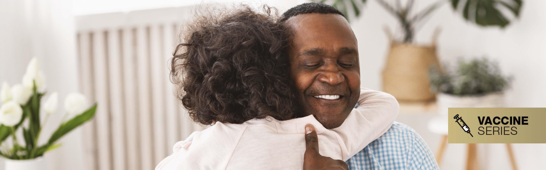 Little girl hugs grandpa