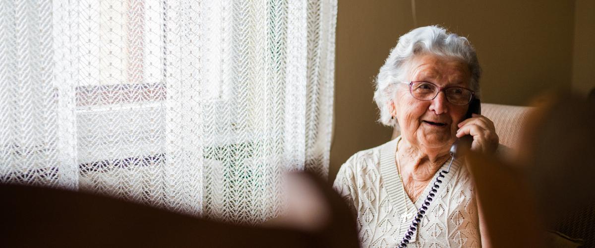 Older adult talking on her phone